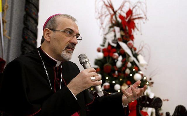 L'archevêque Pierbattista Pizzaballa, L'archevêque Pierbattista Pizzaballa, administrateur apostolique du Patriarcat latin durant une conférence de presse dans les locaux du Patriarcat, dans la Vieille Ville de Jérusalem, le 20 décembre 2017. (Crédit : AFP / GALI TIBBON)