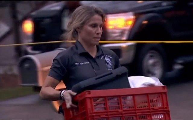 La police de l'État de Virginie récolte les preuves de la maison des Fricker, à Reston, où Scott et son épouse Buckley Kuhn-Fricker ont été abattus le 22 décembre 2017. (Crédit : capture d'écran NBC Washington News)