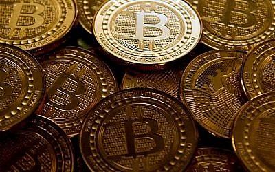 Des pièces de Bitcoin (Photo AFP / Karen Bleier)