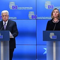 "Palestinian President Mahmoud Abbas (L) speaks as EU foreign policy chief Federica Mogherini listens prior to attend a EU foreign affairs council at the European Council in Brussels, January 22, 2018. Palestinian leader Mahmud Abbas on January 22 urged EU member states to ""swiftly"" grant official recognition to the state of Palestine as he arrived to meet foreign ministers from the bloc in Brussels. EMMANUEL DUNAND / AFP"