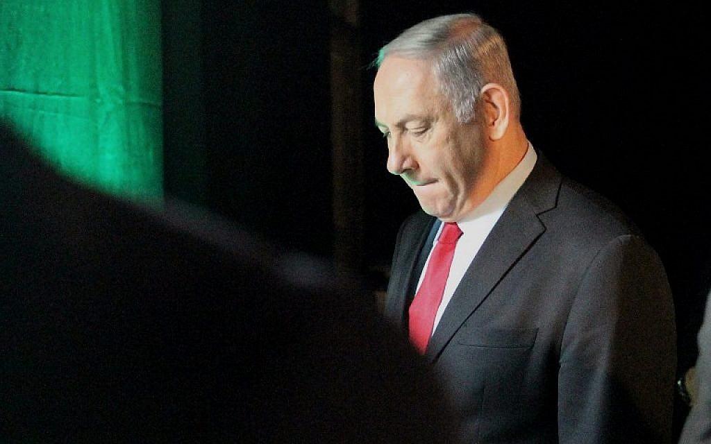 Le Premier ministre Benjamin Netanyahu quitte la conférence Muni World, à Tel Aviv, le 14 février 2018. (AFP PHOTO / JACK GUEZ)