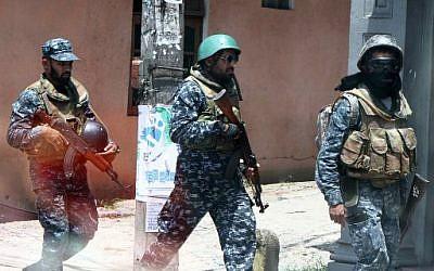 Des soldats de l'armée sri-lankaise patrouillant dans les rues de Digana, dans la banlieue de Kandy, le 8 mars 2018 (AFP PHOTO)