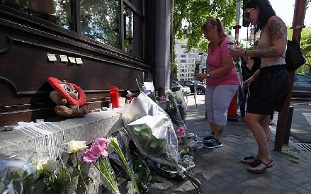 Les Liégeois rendent hommage aux victimes de l'attentat du 29 mai 2018. (Crédit : AFP PHOTO / Emmanuel DUNAND)