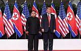 Le président Donald Trump, à droite, et le leader nord-coréen Kim Jong Un, à gauche, au début de leur sommet historique Etats-Unis-Corée du Nord, au Capella Hotel, sur l'île de Sentosa de Singapour, le 12 juin 2018 (Crédit : AFP / SAUL LOEB)