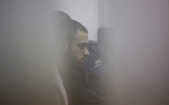 L'agent de la police des frontières Ben Deri, qui a été plus tard condamné pour l'homicide d'un adolescent palestinien de 17 ans dans la ville de Beitunia, en Cisjordanie, lors d'une audience à huis-clos à la cour de district de Jérusalem, le 7 décembre 2014 (Crédit : Yonatan Sindel/Flash90)