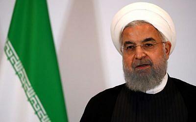 Le président iranien Hassan Rouhani assiste à une conférence de presse à Berne le 3 juillet 2018. (Crédit : AFP/Ruben Sprich)