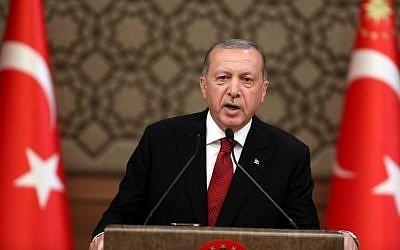 Le président turc Recep Tayyip Erdogan annonce son nouveau gouvernement après avoir prêté serment en tant que premier président sous le nouveau système gouvernemental à Ankara, le 9 juillet 2018. (Crédit : ADEM ALTAN / AFP)