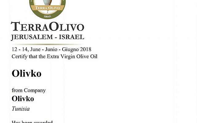 Capture d'écran du certificat de médaille d'or obtenu par la compagnie tunisienne Olivko lors du concours TerraOlivo (Crédit: capture d'écran Terraolivo.org)