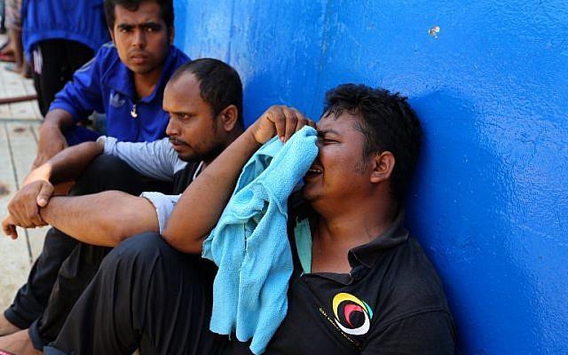 Photo d'illustration. Des migrants secourus à bord d'un bateau, le 1er août 2018. (Crédit : / AFP PHOTO / FATHI NASRI)