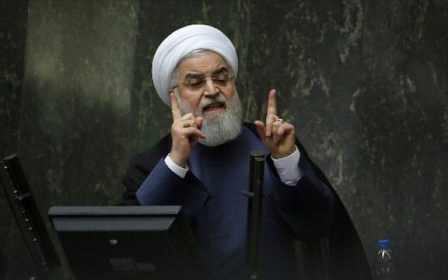 Le président Hassan Rouhani s'exprime devant le parlement à Téhéran, le 28 août 2018. (Crédit : AFP / ATTA KENARE)