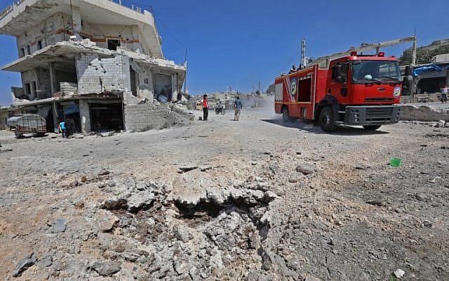 La ville rebelle de Muhambal,dans la province d'Idleb, le 4 septembre 2018, ravagée après une frappe attribuée à la Russie. (Crédit : AFP / OMAR HAJ KADOUR)