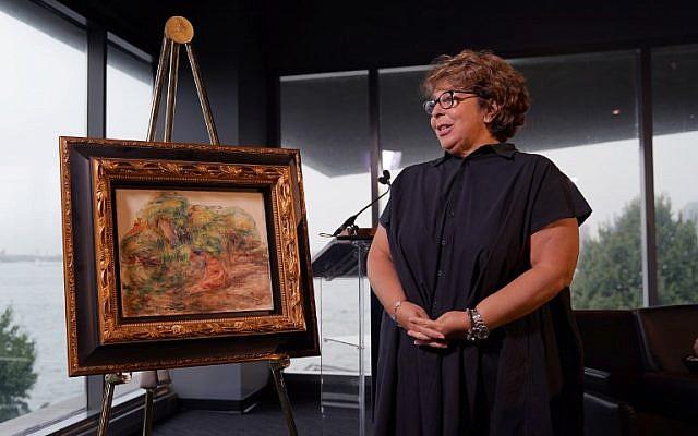Un tableau de Renoir, 'Deux Femmes Dans Un Jardin,' volé par les nazis, a été restitué à Sylvie Sulitzer, durant une cérémonie au Museum of Jewish Heritage à New York le 12 septembre 12. (Crédit : AFP/Timothy A. Clary)