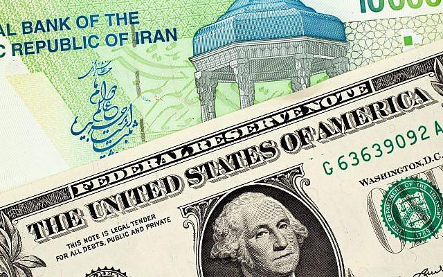 Un billet de banque iranien et un dollar américain. (Crédit : iStock)
