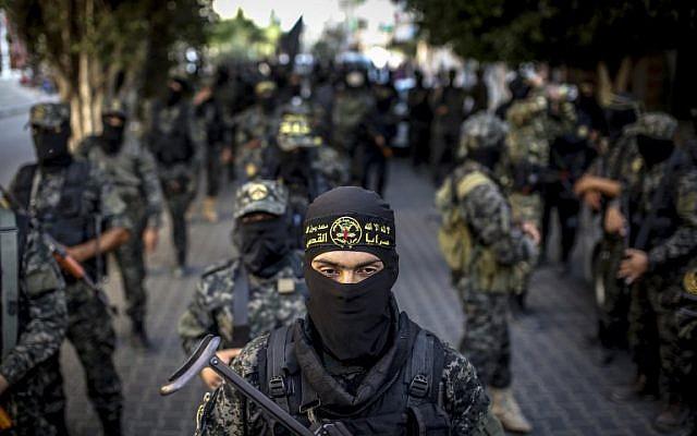 Une parade militaire du Jihad islamique, à Gaza, le 4 octobre 2016. (Crédit : AFP / Anas BABA)