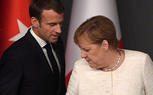 Le président français Emmanuel Macron et la chancelière allemande Angela Merkel à un sommet sur la Syrie à Istanbul, le 27 ocotbre 2018. (Crédit : OZAN KOSE / AFP)