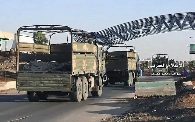 Convoy of Syrian military vehicles at Naseeb border crossing with Jordan, in the southern province of Daraa, Syria, July 7, 2018. (Syrian Central Military Media, via AP)