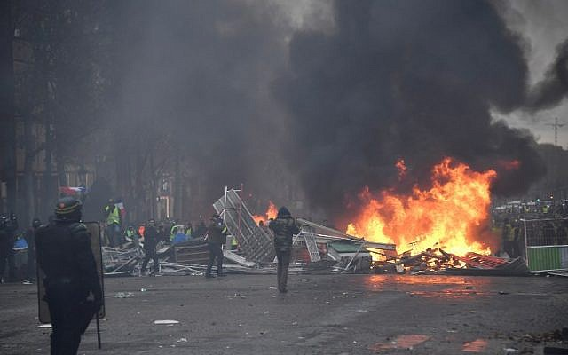 La police anti-émeutes place de la Concorde à Paris, le 24 novembre 2018 (Crédit : Photo by Bertrand GUAY / AFP)