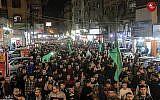 """Des membres du Hamas lors d'un défilé à Jabalya à Gaza """"en soutien à la résistance"""", à la suite d'un cessez-le-feu avec Israël après deux jours de violences, le 13 novembre 2018. (Crédit : capture d'écran Twitter)"""