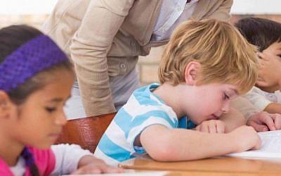 Photo d'illustration d'enfants passant un examen à l'école (Crédit : Shutterstock)