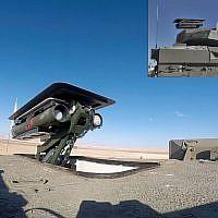 Un système de missile anti-chars sans pilote Spike est vu au sommet de la tourelle d'un véhicule de transport de troupes blindé Namer. (Crédit : ministère de la Défense)