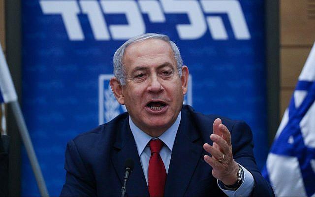 Le Premier ministre Benjamin Netanyahu annonce la tenue d'élections en avril 2019, lors d'une réunion de faction du Likud à la Knesset, le 24 décembre 2018. (Yonatan Sindel/FLASH90)