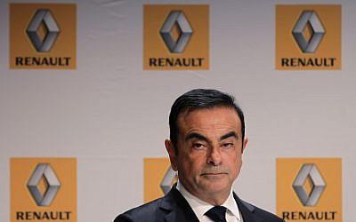 CArlos Ghosn, alors PDG de Renault, lors d'une conférence de presse à Sandouville, le 30 septembre 2014. (Crédit : CHARLY TRIBALLEAU / AFP)