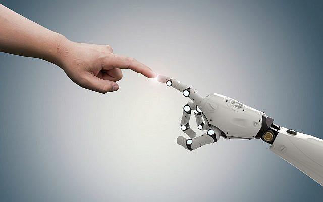 Illustration : une main jhumaine et une main robotisée. (Crédit : PhonlamaiPhoto; iStock by Getty Images)