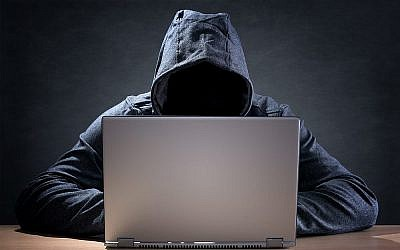 Image illustrative d'un hacker, via Shutterstock.