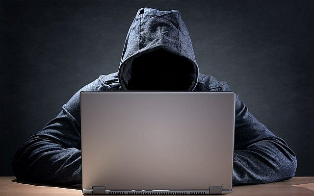 Image illustrative d'un hacker, via Shutterstock.