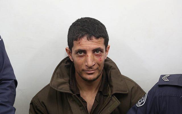 Arafat Irfayia, accusé du meurtre d'Ori Ansbacher, à la Cour des magistrats de Jérusalem, le 11 février 219. (Crédit : Yonatan Sindel/Flash90)