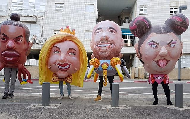 Des nouvelles têtes géantes à l'effigie de Stephane Legar Eden Ben Zaken, Omer Adam et Netta Barzilai pour la parade Adloyada de Pourim, à Holon en 2019. (Crédit : Adloyada)