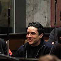 Mehdi Nemmouche écoute le verdict lors du procès à la cour d'Assises de Bruxelles sur la tuerie du Musée juif de Bruxelles, le 12 mars 2019. (Crédit : YVES HERMAN / POOL / AFP)