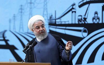 Le président iranien Hassan Rouhani en conférence de presse à Téhéran, le 26 août 2019. (Crédit : Bureau du président iranien via AP)