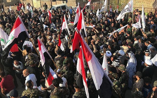 Funérailles d'Abu Ali al-Dabi, membre du Hachd al-Chaabi, tué dans une frappe attribuée à Israël, le 26 août 2019. (Crédit : AP Photo/Ali Abdul Hassan)