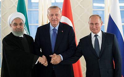 Le président iranien Hassan Rouhani, son homologue turc Recep Tayyip Erdogan et le président russe Vladimir Poutine lors d'une rencontre trilatérale autour de la Syrie, à Ankara le 16 septembre 2019. (Crédit : Pavel Golovkin / POOL / AFP)