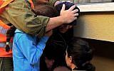 Photo illustrative d'une attaque de missile en 2009 à Ashkelon. (AP Photo/Tsafrir Abayov)