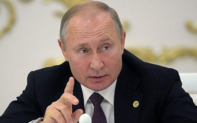 Le président russe Vladimir Poutine participe à une rencontre des chefs de la Communauté des Etats indépendants CEI à Ashgabat, Turkémistan, le 11 octobre 2019.   (Alexey DRUZHININ / SPUTNIK / AFP)
