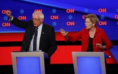 Photo d'illustration : Le sénateur Bernie Sanders (Indépendant -Vermont) et la sénatrice Elizabeth Warren (Démocrate-Massachusetts)  pendant le premier de deux débats de la nomination démocrate à la présidentielle sur CNN à Detroit, le 30 juin 2019 (Crédit : AP Photo/Paul Sancya)