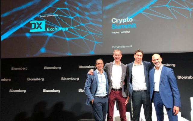 Les représentants de DX.Exchange au sommet des crypto-devises de Bloomberg à Londres, au mois de décembre 2018 (Crédit : Facebook)