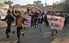 Des soutiens irakiens du groupe armé Hashed Al-shaabi manifestent sur la place Tahrir de la capitale Baghdad, le 5 décembre 2019. (Photo par AHMAD AL-RUBAYE / AFP)