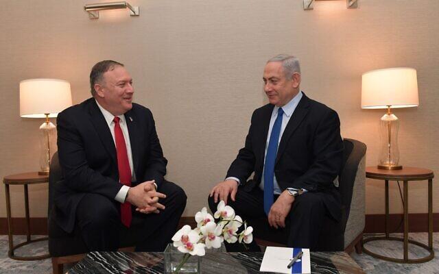 Le secrétaire d'État américain Mike Pompeo, (à gauche), rencontre le Premier ministre israélien Benjamin Netanyahu à Lisbonne, le 4 décembre 2019. (Kobi Gideon/GPO)