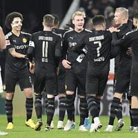 Des joueurs du Borussia Dortmund à Augsburg, le 18 janvier 2020. (Crédit : HOMAS KIENZLE / AFP)