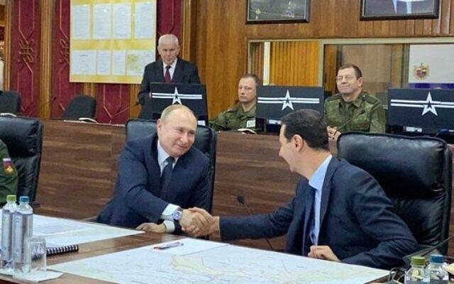 Vladimir Poutine et Bachar al-Assad à Damas, en Syrie, le 7 janvier 2020. (Crédit : SANA)