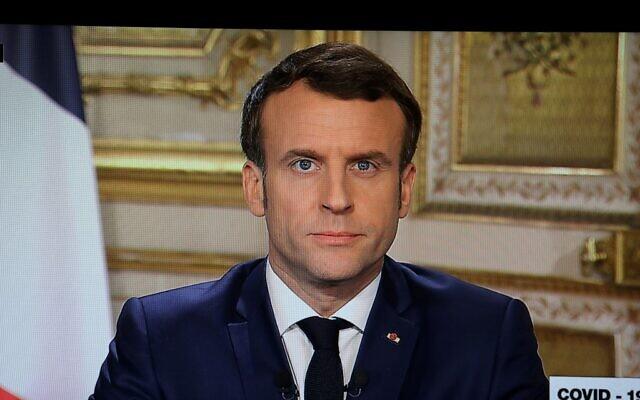 Emmanuel Macron annonce en direct depuis le Palais de l'Elysée à Paris les mesures prises concernant la situation de l'épidémie de COVID-19, causée par le nouveau coronavirus, le 12 mars 2020. (Crédit : Ludovic Marin / AFP)