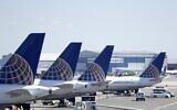 Des avions de United Airlines sont stationnés au Terminal C de l'aéroport international Newark, le 18 juillet 2018, à Newark, N.J. (Crédit : AP /Julio Cortez)