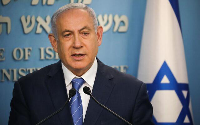 Le Premier ministre Benjamin Netanyahu au cours d'une conférence de presse sur le coronavirus au bureau du Premier ministre de Jérusalem, le 25 mars 2020. (Crédit : Olivier Fitoussi/Flash90)