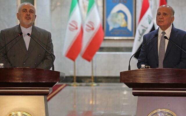 Le ministre iranien des Affaires étrangères Mohammad Javad Zarif (gauche) s'exprime lors d'une conférence de presse avec son homologue irakien Fuad Hussein (droite) à la suite de leur réunion à Baghdad  le 19 juillet 2020. (Photo par AHMAD AL-RUBAYE / AFP)