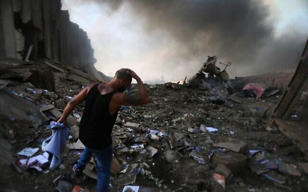 Le site d'une explosion dans le port de la capitale libanaise de Beyrouth, le 4 août 2020. (Crédit : STR / AFP)