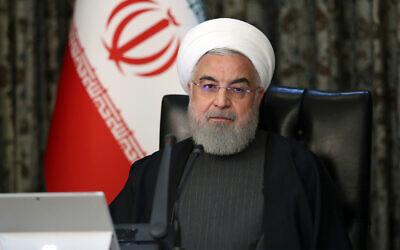 Le président iranien Hassan Rouhani assiste à une réunion de cabinet à Téhéran, Iran, le 18 mars 2020. (Bureau de la présidence iranienne via AP)