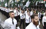 Des membres du Mouvement de résistance nordique d'extrême droite défilent dans la ville de Ludvika, dans le centre de la Suède, le 1er mai 2018. (Ulf Palm/AFP via Getty Images)